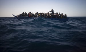 Migrants from Eritrea, Egypt, Syria and Sudan wait to be assisted by the Spanish NGO Open Arms after fleeing Libya last month.