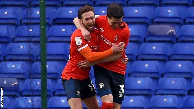 Luton left-back Dan Potts celebrated his first goal of the season with the help of Jordan Clark