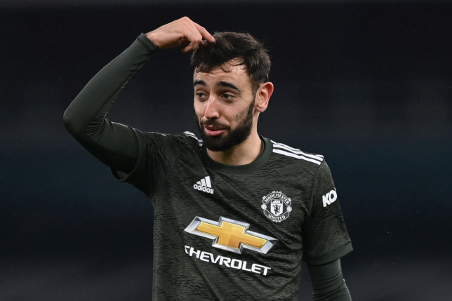 Manchester United's Portuguese midfielder Bruno Fernandes reacts after sending a shot wide during the English Premier League football match between Arsenal and Manchester United at the Emirates Stadium in London on January 30, 2021. (Photo by Shaun Botterill / POOL / AFP) / RESTRICTED TO EDITORIAL USE. No use with unauthorized audio, video, data, fixture lists, club/league logos or 'live' services. Online in-match use limited to 120 images. An additional 40 images may be used in extra time. No video emulation. Social media in-match use limited to 120 images. An additional 40 images may be used in extra time. No use in betting publications, games or single club/league/player publications. / (Photo by SHAUN BOTTERILL/POOL/AFP via Getty Images)