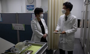 Medical workers prepare for the vaccination rollout at a public health centre in Seoul.