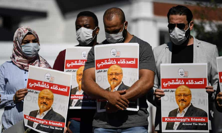 Friends of Jamal Khashoggi hold posters bearing his picture as they attend an event on the second anniversary of his assassination, in front of the Saudi Arabian consulate in Istanbul in October.