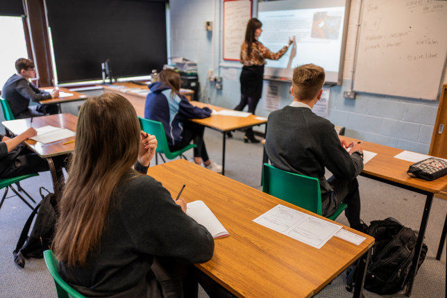 Pupils sit apart during a socially distanced language lesson at Longdendale High School on July 16, 2020