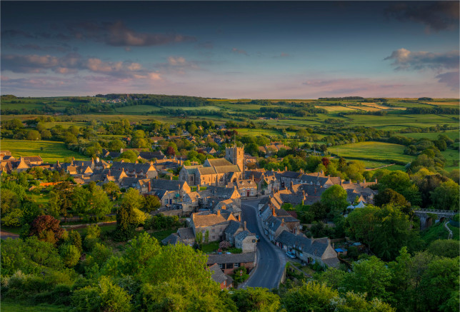 An overview of the beautiful small village of Corfe on the Isle of Purbeck in warm evening light. Dorset England.