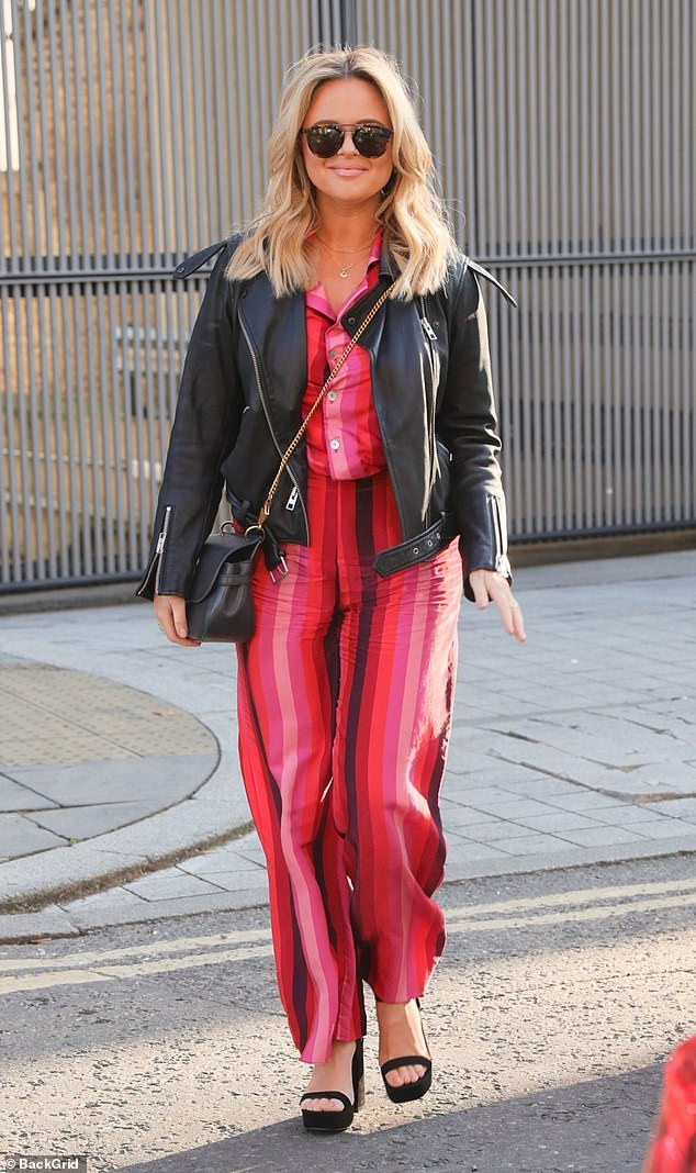 Power suit: Emily Atack looked incredible as she was pictured leaving the studios in a pink and red striped trouser suit from Never Fully Dressed on Saturday morning