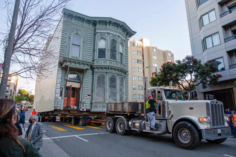 The 139-year-old Victorian house known as the Englander House is hoisted on a flat bed and pulled down Franklin Street towards its new location six blocks away, as the original site is to be used to build a 48-unit, eight-story apartment building, in San Francisco, California, U.S. February 21, 2021. REUTERS/Brittany Hosea-Small