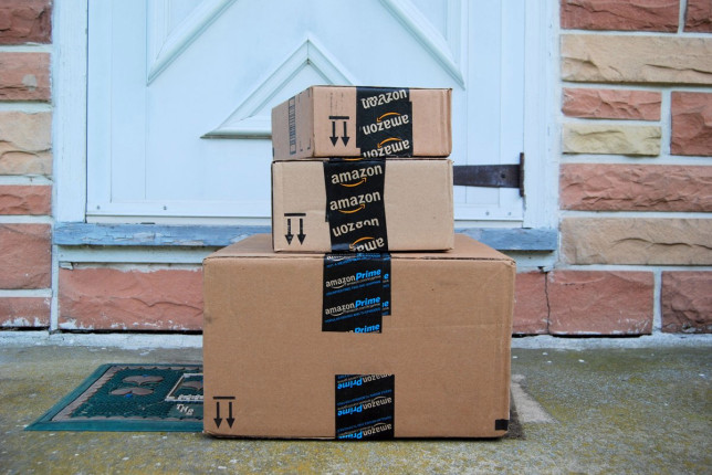 Image of an Amazon packages outside a house.