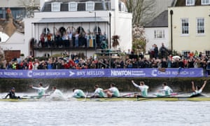 Cambridge celebrate after crossing the line to win the 2016 university boat race, sponsored by US bank BNY Mellon.
