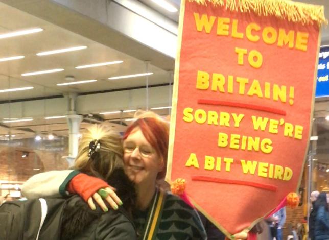 Suzi Warren holding a sign
