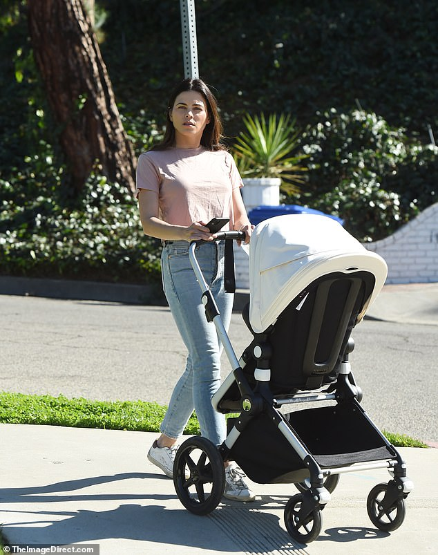 Mom duty:Jenna Dewan was spotted pushing the stroller of her baby boy Callum while on a leisurely stroll through Los Angeles on Saturday