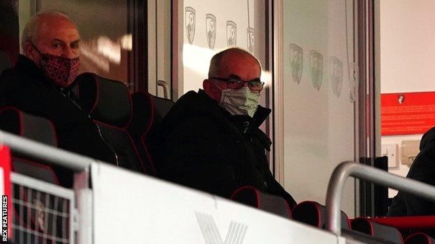 Joe Jordan watches Bournemouth v Cardiff City from the stands
