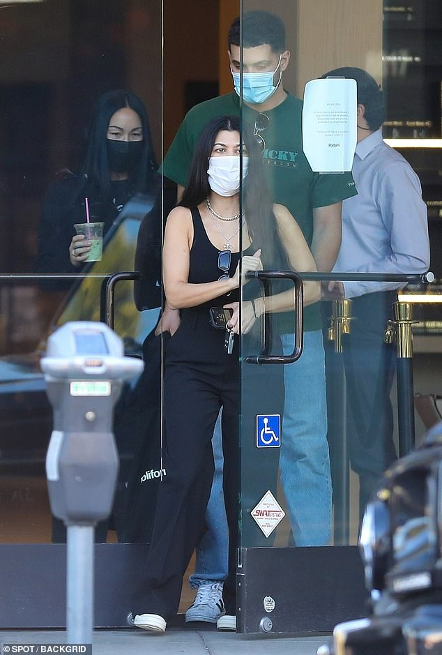 Running errands: Kourtney Kardashian stepped out without her new boyfriend Travis Barker to go furniture shopping with her friends Fai Khadra and Luka Sabbat