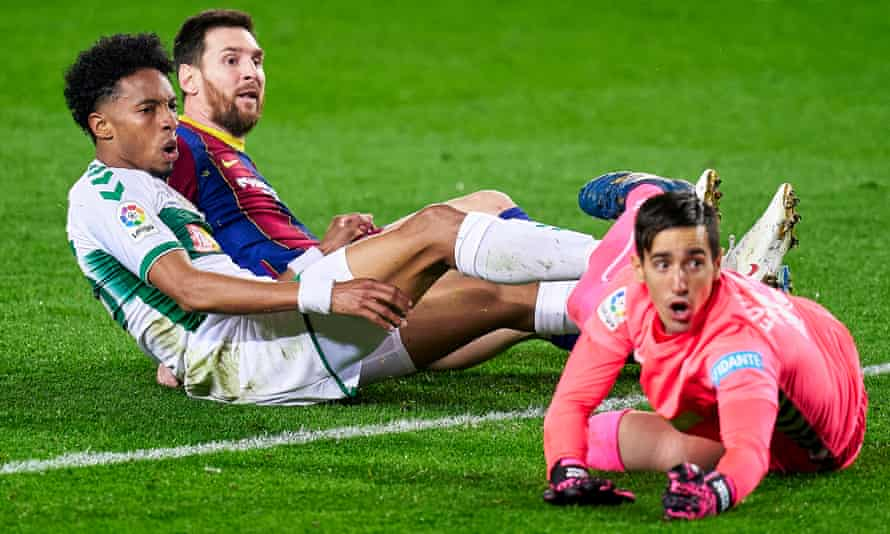 Lionel Messi scores Barcelona's first goal against Elche at the Camp Nou.