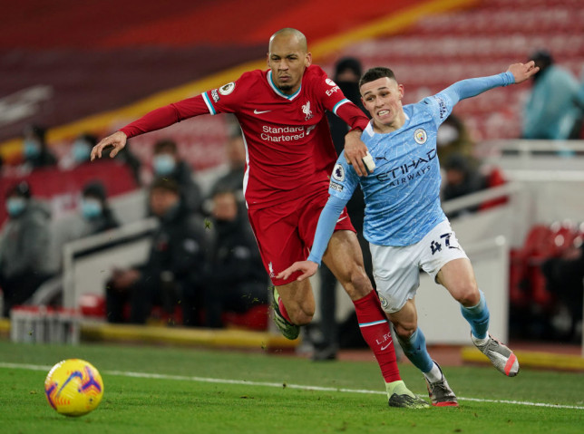 Fabinho battles Phil Foden for the ball during Liverpool's Premier League clash with Manchester City
