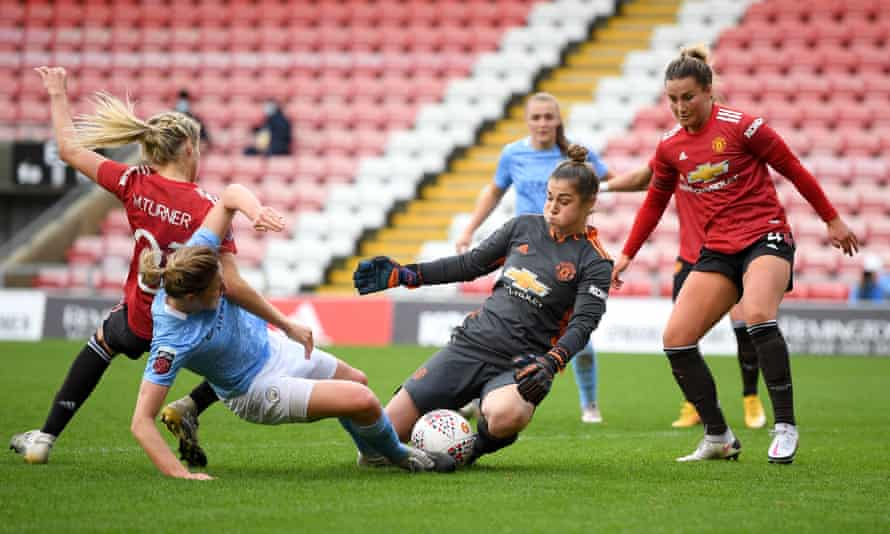 Mary Earps saves from Manchester City's Ellen White during November's Women's Super League match.