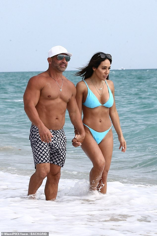 Staying close:Melissa Gorga held hands with Joe as they enjoyed a beach day together with their family in Miami on Wednesday