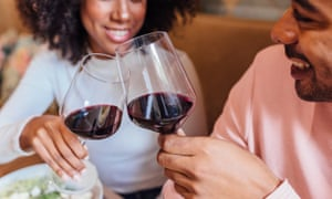 Happy Romantic Couple Toasting With Wineglasses In Cafe