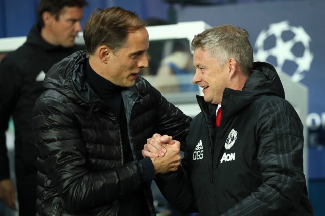 Paris Saint-Germain Manager / Head Coach Thomas Tuchel greets Manchester United Head Coach / Manager Ole Gunnar Solskjaer prior to the UEFA Champions League Round of 16 Second Leg match between Paris Saint-Germain and Manchester United at Parc des Princes on March 6, 2019 in Paris, France.