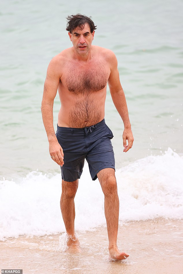 Phoar-rat! Sacha Baron Cohen (pictured) was looking nothing like his famous Borat character when he showed off his fit physique during a swim at a Sydney beach on Saturday