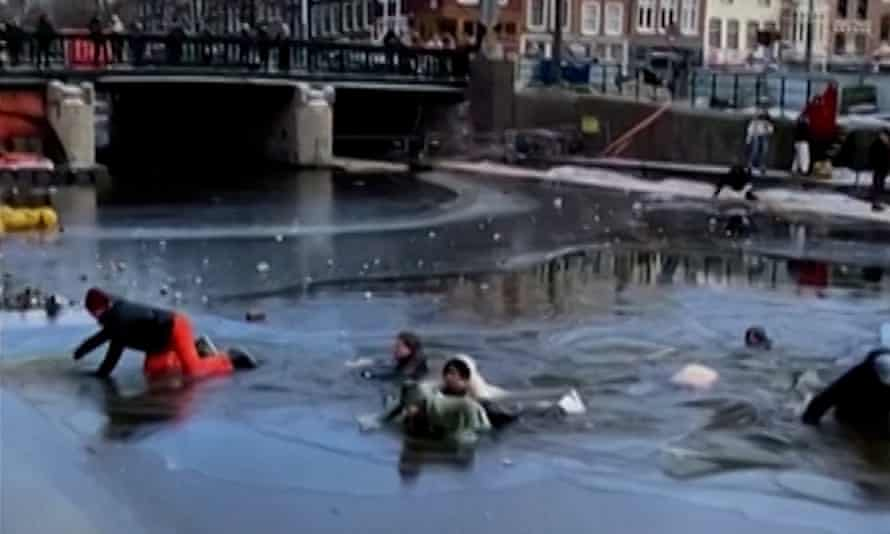 A group of skaters falls through ice on Amsterdam's canals on Sunday.