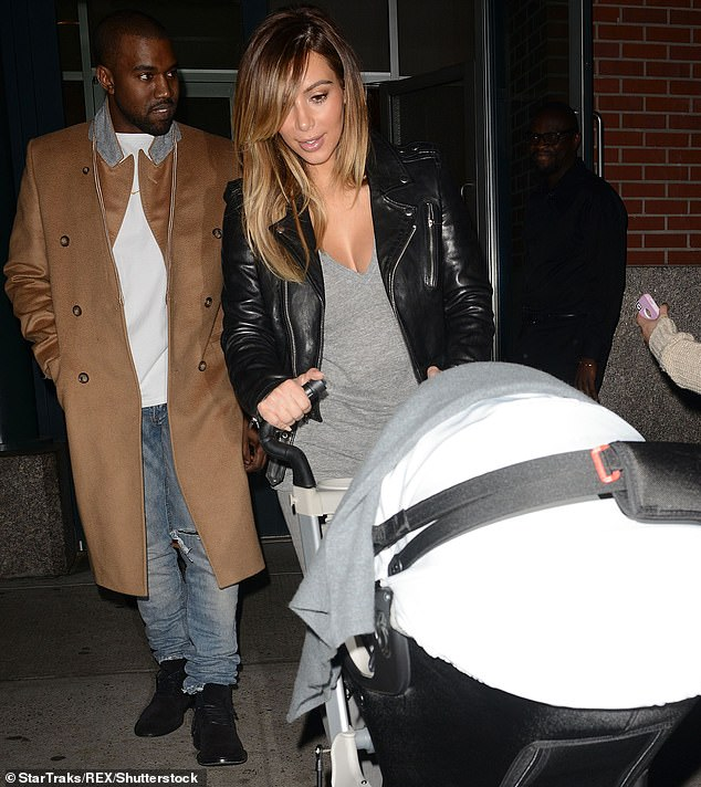 Off to a great start: The power couple seen wit a stroller in New York City in 2013