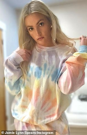 Colorful:The actress and singer posed in a pastel tie-dye sweatshirt and matching sweatpants, while joking in her Insta Stories that she blurred the background to hide the messy room