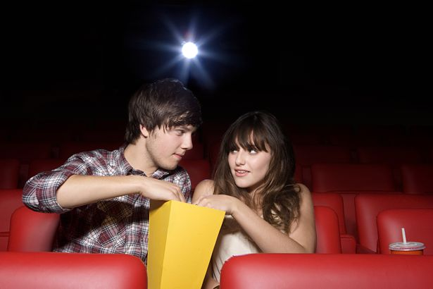 Cinemas remain closed in Step Two of the roadmap (file photo of a couple sharing popcorn)