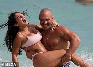 Joe playfully tossed daughter Antonio in the water