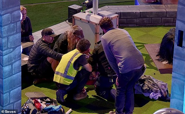 Painful: Medics, producers and production staff rushed to Denise's aide as she lay on the ground writing in agony
