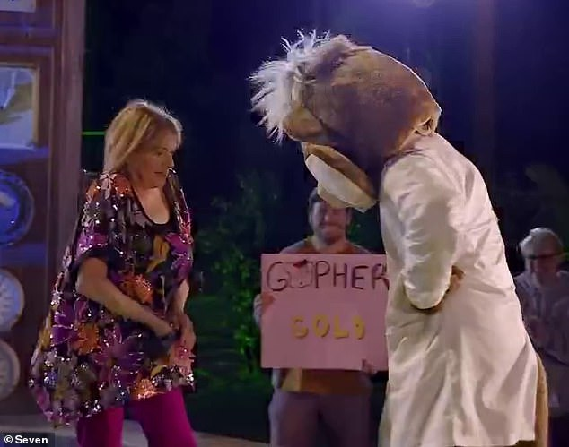 Gopher gold! As part of the Frankenstein-themed course, contestants who missed their shots were zapped by an 'electric shock machine' - which was controlled by an actor wearing an 'evil gopher' costume (right)