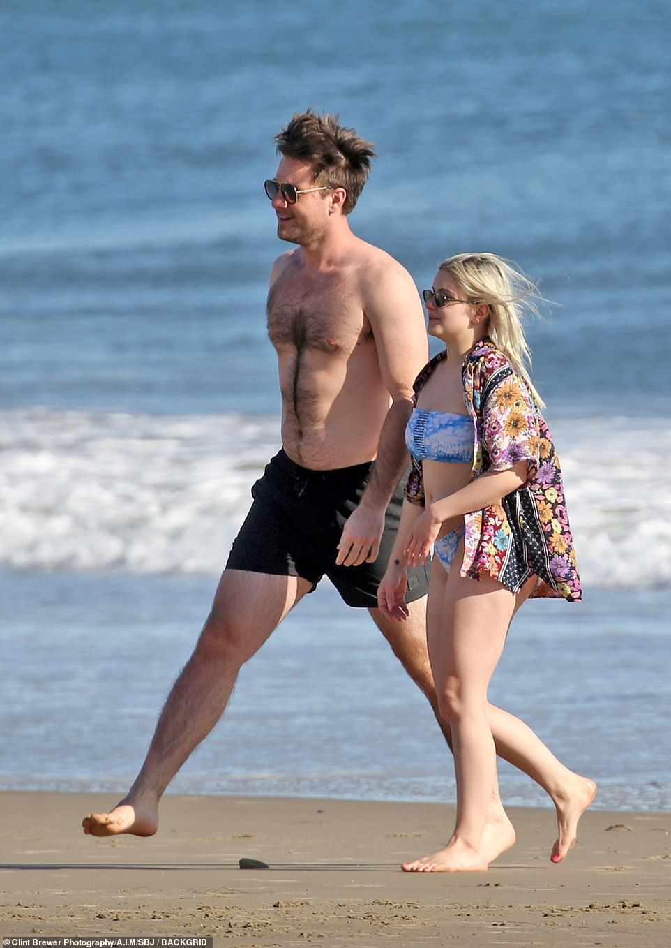 Happy couple: The 23-year-old Modern Family star was joined by her hunky boyfriend Luke Benward, who could be skimming rocks with her and packing on the PDA