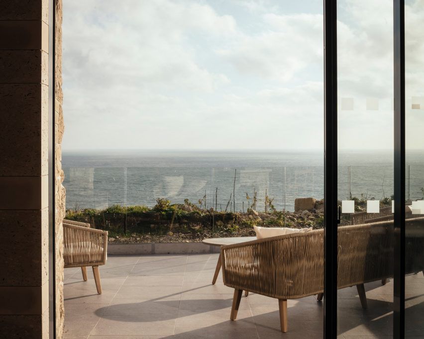 Terrace with view across the sea by Morrow + Lorraine