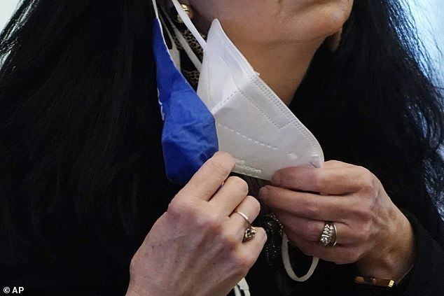 A state legislator adjusts her face masks while asking a question at the Capitol.Official UK guidancerecommends that masks be made with at least two layers of fabric (file photo)