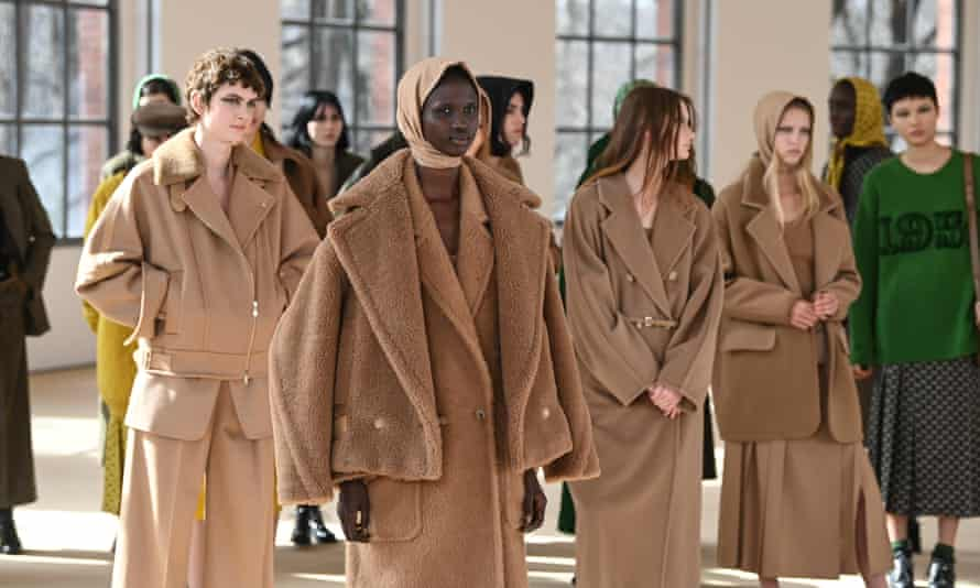 Models gather for the finale of the Max Mara show in Milan