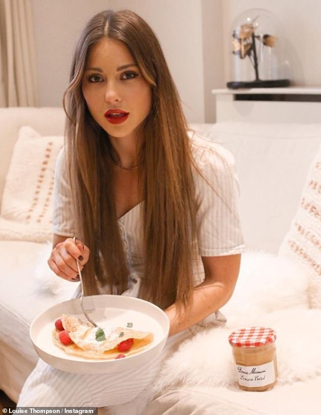 Tucking in: The TV personality pictured herself plunging a fork into the strawberry filled treat