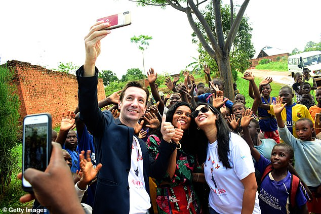 Attanasio, pictured holding a phone to take a selfie, was married and had been stationed in the Democratic Republic of Congo for three years