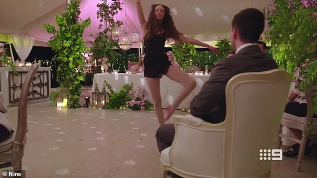That's something!Stripping off her wedding dress and donning a leotard, Belinda sat her groom in a chair and danced around him passionately