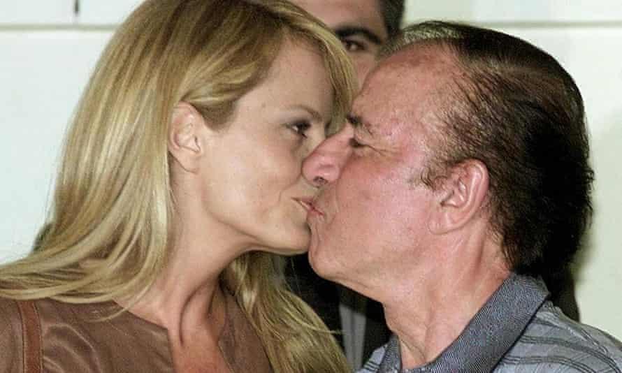 FILES-ARGENTINA-MENEM-OBIT(FILES) In this file photo taken in November, 2001, Cecilia Bolocco kisses her then husband, Carlos Menem, in Santiago.