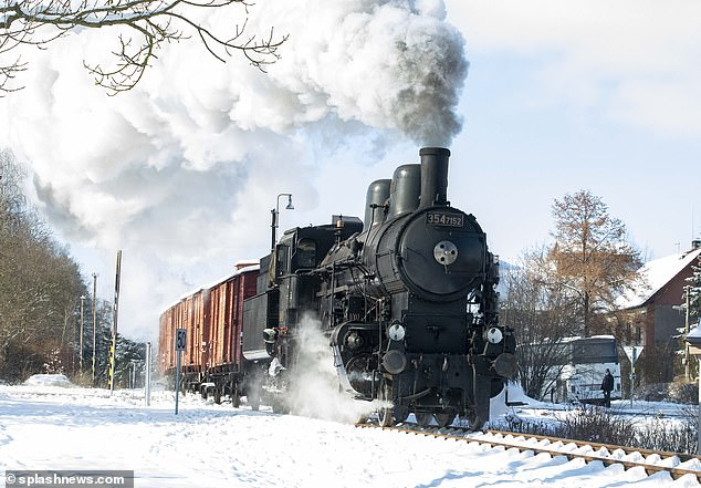 History brought back to life: A train which resembled an old railway system was seen on set