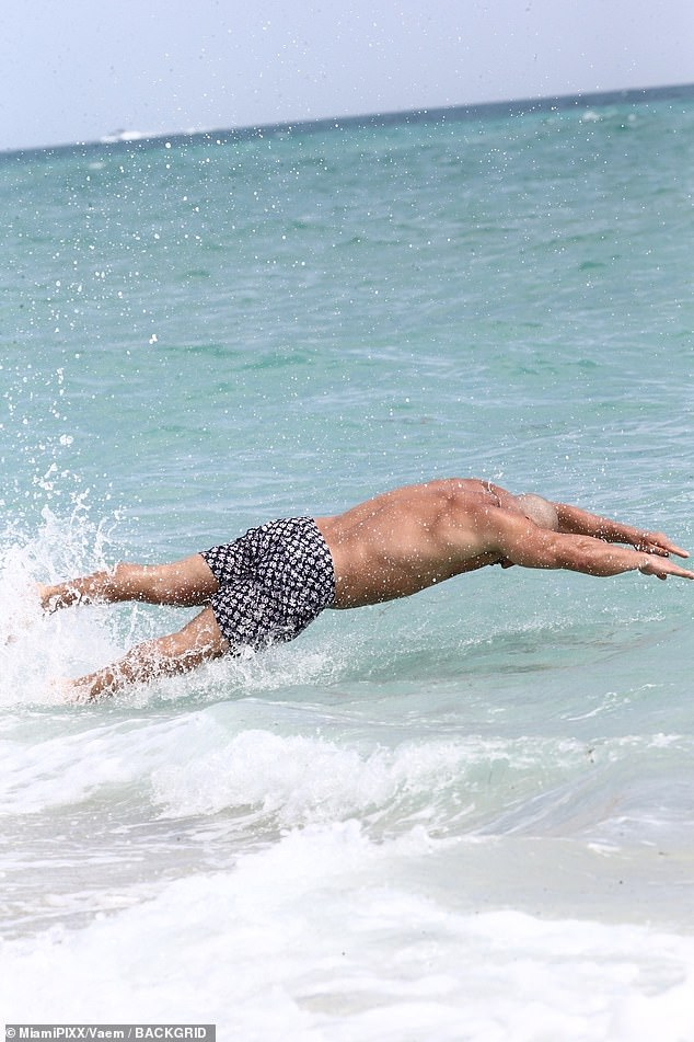 Diving in: Joe was ready for a swim as he gracefully dived in