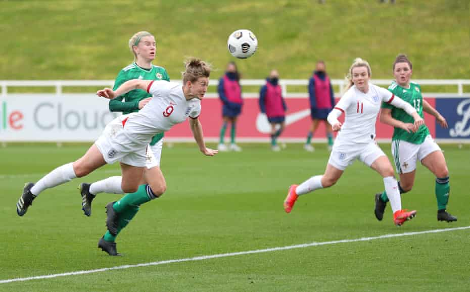 Ellen White dives to head home England's second.