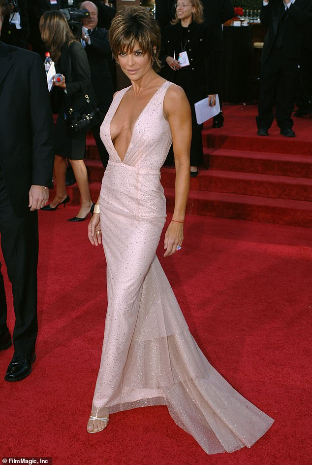 Funny as always: Lisa Rinna was in white as she said: 'I had my Golden Globes out for this GG 2006'