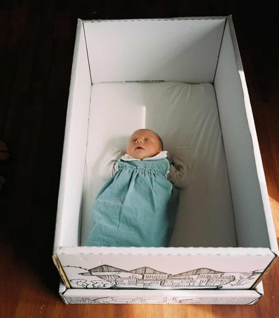 Debbie's newborn baby asleep in the Scottish baby box, which provides a safe place to sleep and comes full of baby essentials.