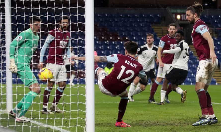 urnley's Robbie Brady fails to clear off the line as Fulham's Ola Aina (second right) scores the opening goal.