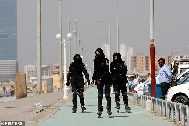 The unit has already begun patrolling Karachi's bustling beachfront. Pictured: Three police officers rollerblade along the seafront during practice inKarachi