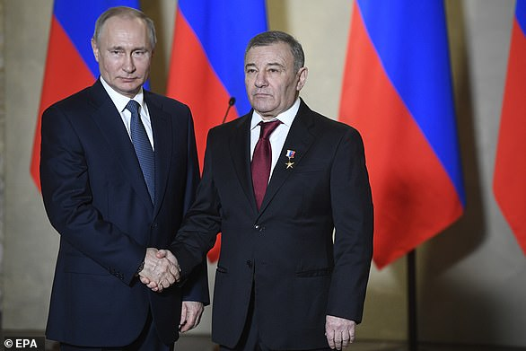 Pictured: Russian President Vladimir Putin (L) decorates businessman Arkady Rotenberg (R) with the Hero of Labour medal during an awards ceremony