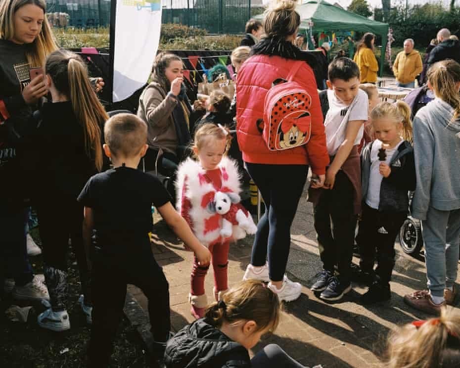 Children wait in the queue for face painting, at the Women Against Capitalism 'Care and Share' event, Castlemilk.