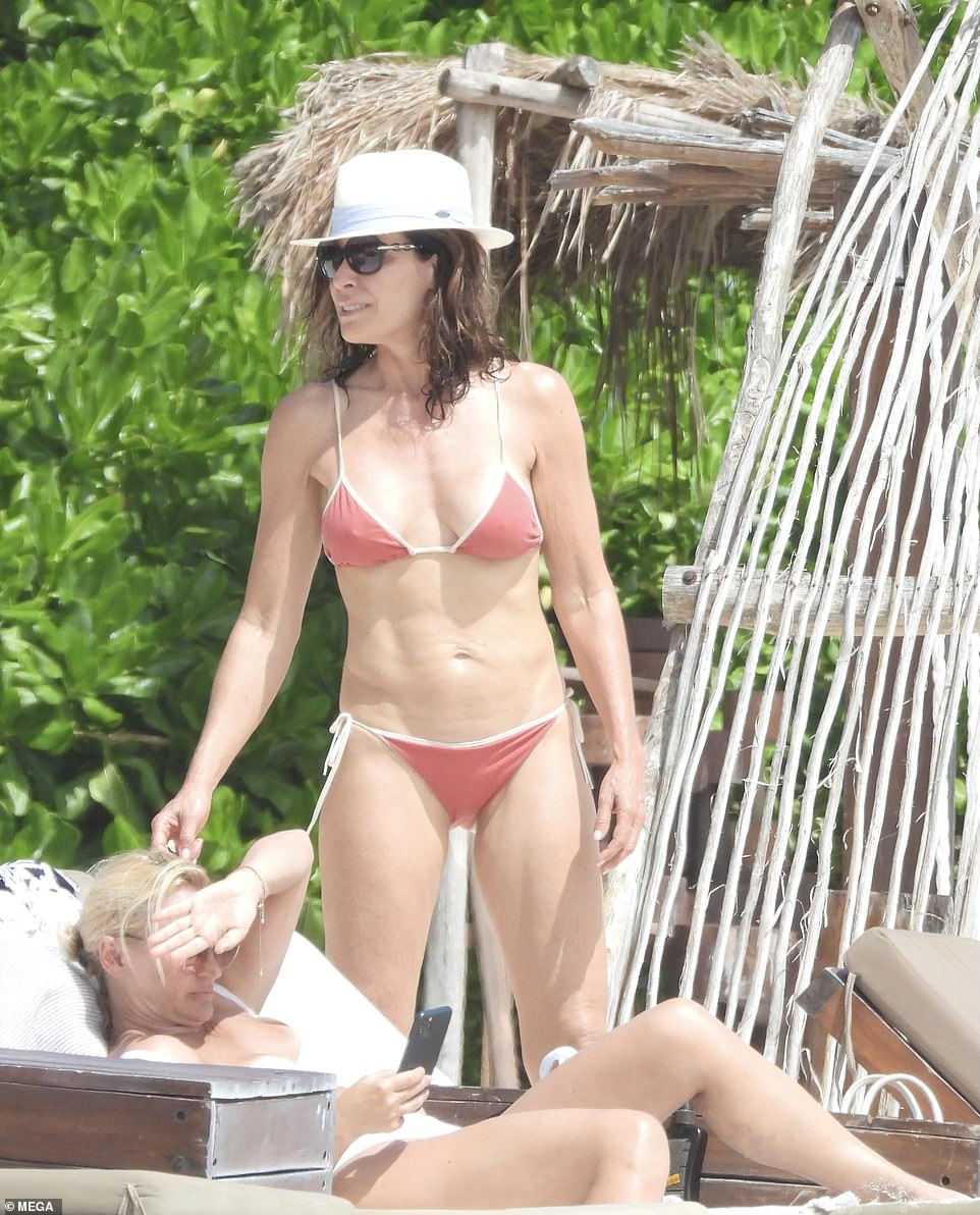 Hat's off to her: Luann protected herself from the sunshine beneath a cool white hat