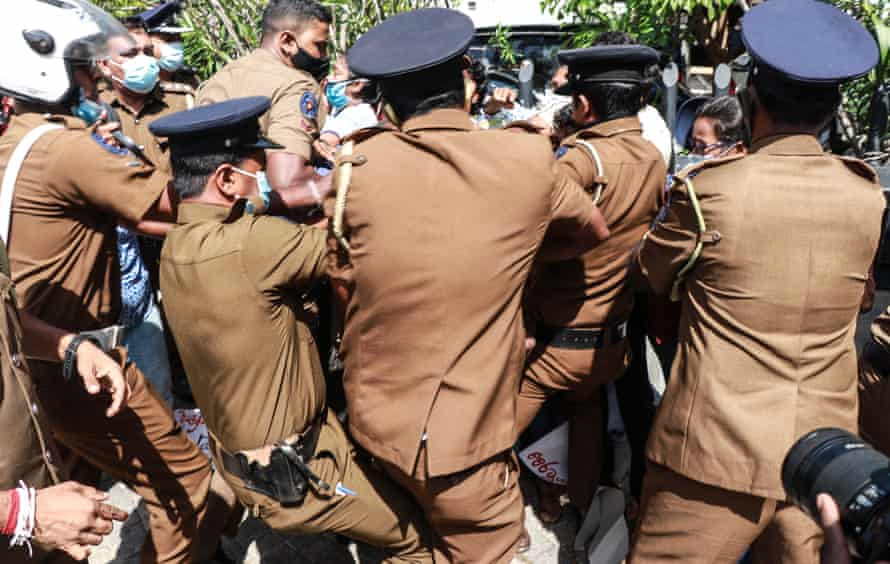 Activists of the Frontline Socialist party (FSP) are taken into police custody for breaching quarantine laws during a protest against the murder of George Floyd, outside the US embassy in Colombo.