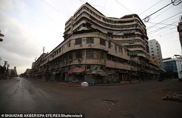 Pictured: A view of Karachi during lockdown, showing potholes in the abandoned streets. The city is reportedly known for its rough roads that could prove challenging for rollerbladers
