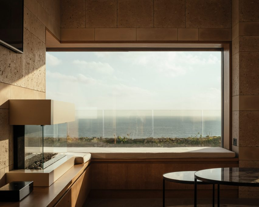 Wood and stone frame the views by Morrow + Lorraine